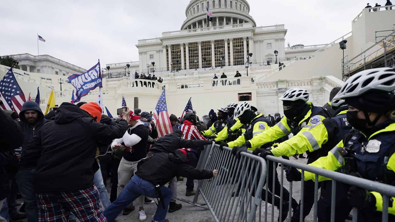 Trump supporters try to break through a police barrier Wednesday at the U.S. Capitol.